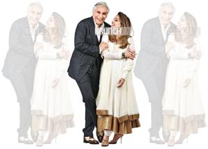 By now, Navin and Raseel  have celebrated 27 wedding anniversaries with their family of three children and a household that even includes Navin's former wife. On Navin: Suit, Tom Ford; shirt, Pink; pocket square, Casa Pop; shoes, Tom Ford. On Raseel: Suit; Rohit Bal; jewellery, Alpana Gujral; shoes, Bombay Gossip