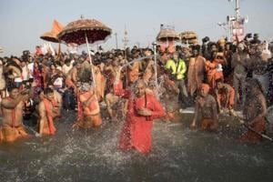 Sadhus bathe at the Sangam on