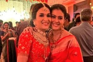 Kajol poses with the new bride, Soundarya Rajinikanth at the latter's Chennai reception.