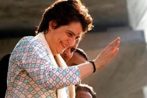Priyanka Gandhi Vadra waves to her supporters during a roadshow in Lucknow on Monday.