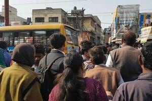 Locals gathered at the spot where an unidentified woman was mowed down by a private school bus in Greater Noida's Dadri area.