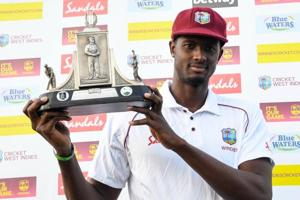 Jason Holder of West Indies holds the Wisden trophy at the end of day 4 of the 3rd and final Test between West Indies and England at Darren Sammy Cricket Ground.