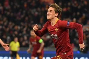 AS Roma Italian midfielder Nicolo Zaniolo (R) celebrates after opening the scoring during the UEFA Champions League round of 16 match.