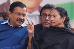 "Chief Minister of Delhi, Arvind Kejriwal, talks with Chief Minister of West Bengal, Mamata Banerjee, during the ""Save Democracy"" rally to protest against ruling Bharatiya Janata Party (BJP) government in New Delhi."