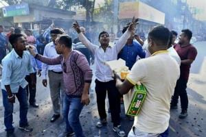 Activists of Assam Jatiya Yuba Chatra Parishad (AJYCP) distribute sweet items and burst fire-crackers as they celebrate  in Guwahati after the Citizenship (Amendment)  Bill could not be tabled in the Rajya Sabha on  Wednesday.