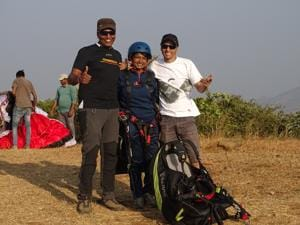 (From left) Vijay Soni, coach; Amrapali Chavan, paralympic glider and Ajay Sharma, pilot at Kamshet Peak, Lonavla seen in a celebratory mood.