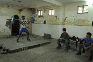 Weightlifters during a practice session at the basement of the Nehru Stadium, Gurugram.
