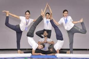 The government is counting on the brand equity of some of India's best-known spiritual and yoga gurus to take the ancient physical and spiritual discipline to the world — albeit by bringing the world to India first.