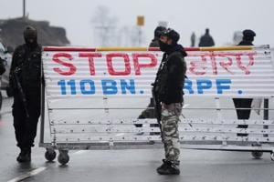 Indian security forces stand guard on a road block along the Srinagar-Jammu Highway following an attack on a paramilitary Central Reserve Police Force (CRPF) convoy on February 14, 2019.