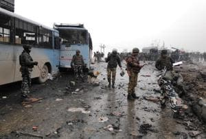 Indian soldiers examine the debris after an explosion in Lethpora in south Kashmir