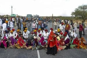 The Gujjar community on Saturday called off their eight-day agitation after Tourism Minister Vishvendra Singh handed over a draft of reservation bill to the Gujjar leaders on the railway tracks at Malarna Dungar.