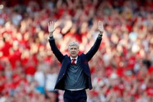 Arsene Wenger waves to fans after his final match in charge of Arsenal.