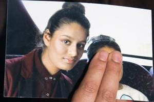 Renu Begum, sister of teenage British girl Shamima Begum, holds a photo of her sister as she makes an appeal for her to return home at Scotland Yard, in London.