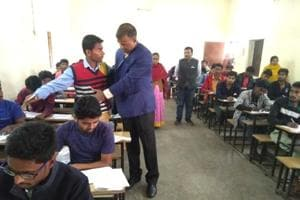 Bihar Board chairman Anand Kishor checking a candidate during the intermediate exam