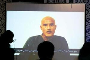 Former Indian navy officer Kulbhushan Sudhir Jadhav is seen on a screen during a news conference at the Ministry of Foreign Affairs in Islamabad, Pakistan on December 25, 2017.
