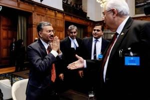 Secretary of Foreign Affairs of India Deepak Mittal (L) and Attorney General of Pakistan Anwar Mansoor Khan (R) greet each other at the International Court of Justice in The Hague, prior to the India-Pakistan case, on February 18, 2019.