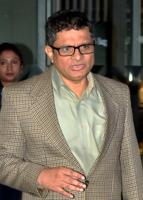 Kolkata Police Commissioner Rajeev Kumar arrives after being questioned by CBI for five consecutive days in connection with chit fund scam cases, at Netaji Subhash Chandra Bose Airport in Kolkata on February 13.