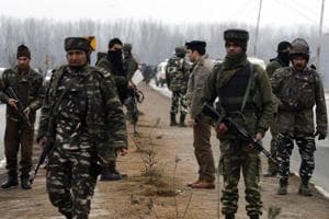 Security personnel inspect  the site of  Thursday's suicide attack on Kashmir's Pulwama district which killed 40 CRPFtroopers.