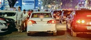 Double parking on MG road (as seen in pictures above and below) is seen as a major problem for shopkeepers, shoppers and commuters.