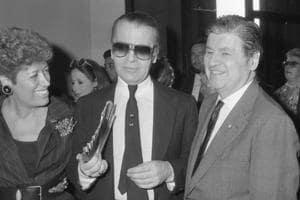 FILE - In this Oct. 5, 1985 file photo, from left, Carla Fendi, Karl Lagerfeld and U.S. Ambassador to Rome, Maxwell Rabb, attend the opening of an exhibition at Rome