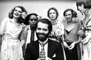 FILE -- In this Nov. 29, 1973 photo German fashion designer Karl Lagerfeld, left, poses with models in Krefeld, Germany. Chanel