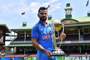 Virat Kohli poses with the ICC Cricket World Cup trophy at the Sydney Cricket Ground in Sydney on January 11.