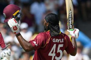Chris Gayle (R) of West Indies celebrates his century during the 1st ODI between West Indies and England at Kensington Oval