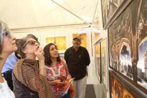 Visitors at HT Imagine Fest 2018 enthral themselves in  discussions over artworks on display.