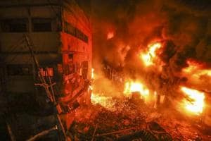 Flames rise fire from a fire in a densely packed shopping area in Dhaka, Bangladesh, Thursday, February 21, 2019.