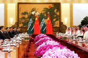 Saudi Crown Prince Mohammed bin Salman (R) attends a meeting with Chinese President Xi Jinping (L) at the Great Hall of the People in Beijing on February 22.