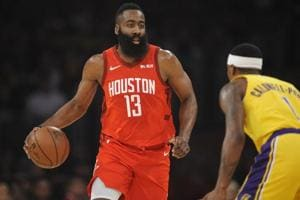 Houston Rockets guard James Harden moves the ball against Los Angeles Lakers guard Kentavious Caldwell-Pope.