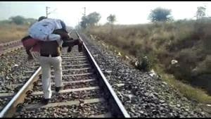 Policeman carrying injured persona on his shoulder in Hoshangabad district on Saturday
