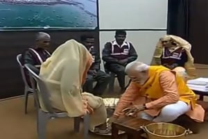 Prime Minister Narendra Modi washes the feet of the sanitation workers.