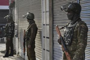 Central Reserve Police Force (CRPF) personnel stand guard outside a closed market area during a shutdown in central Srinagar.