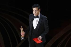 "Rami Malek reacts while holding his Oscar after accepting the Best Actor award for his role in ""Bohemian Rhapsody""."