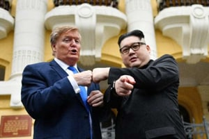 The Kim lookalike, who goes by the name Howard X, popped up in Vietnam's capital of Hanoi on Friday along with his partner who impersonates Trump, drawing crowds and media.