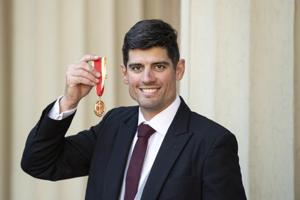 Sir Alastair Cook with his knighthood following an investiture ceremony at Buckingham Palace on February 26, 2019 in London, England)