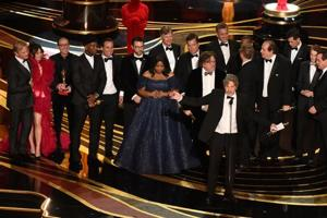 Producers of 'Green Book' Peter Farrelly and Nick Vallelonga accept the award for Best Picture with the whole crew on stage during the Oscars on Sunday.