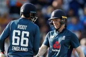 File image of England cricketer Joe Root with skipper Eoin Morgan.
