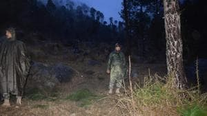 Pakistani soldiers and media personnel gather at the site where the Indian Air Force (IAF) strike launched on a Jaish-e-Mohammad (JeM) camp at Balakot on February 26, 2019.