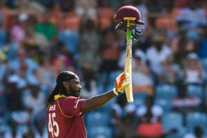 Chris Gayle of West Indies celebrates achieving 10,000 ODI runs during the 4th ODI between West Indies and England at Grenada National Cricket Stadium.