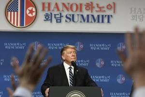 President Donald Trump, left, standing with Secretary of State Mike Pompeo, right, looks to call on a reporter during a news conference in Hanoi, Vietnam, Thursday, Feb. 28, 2019, following his summit with North Korean leader Kim Jong Un.(AP Photo/Susan Walsh)