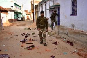 Police action during violence errupted after a photo of 11 youths wearing shirts bearing the Pakistan national flag went viral on social media at Baidpur village of Nirsa block in Dhanbad, India, on Tuesday