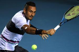 Australian tennis player Nick Kyrgios returns the ball to Spanish tennis player Rafael Nadal (out of frame) during their Mexico ATP 500 Open men