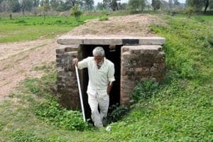 Jammu, India - February 28, 2019: A border villager comes out from a community bunker at Chandu Chak village of Ranbir Singh Pura sector near the India-Pakistan international border, about 35km from Jammu, Jammu and Kashmir, India on Thursday, February 28, 2019. (Photo by Nitin Kanotra / Hindustan Times)