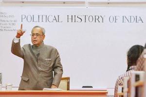 President Pranab Mukherjee teaching students at a government school on Teacher