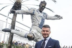 Former LA Galaxy MLS soccer midfielder David Beckham poses with a statue of himself at Legends Plaza in front of Dignity Health Sports Park in Carson.
