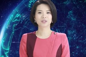 """The artificial intelligence robot named """"Xin Xiaomeng"""" sported a short haircut and wore a pink blouse and earrings in a one-minute video presentation by Xinhua."""