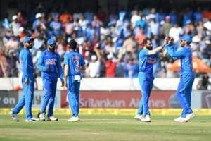 Indian cricketer Mohammed Shami (2R) celebrates with teammates the dismissal of Australian cricketer Glenn Maxwell during the first one day international (ODI) cricket match between India and Australia at the Rajiv Gandhi International Cricket Stadium in Hyderabad
