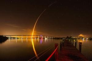 A SpaceX Falcon 9 rocket, carrying the Crew Dragon spacecraft, lifts off on an uncrewed test flight to the International Space Station from the Kennedy Space Center as viewed in Vero Beach, Florida, U.S.